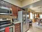 The fully equipped kitchen features granite counters and stainless steel appliances.