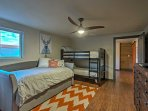 This bedroom features a twin-over-twin bunk bed and a twin daybed with twin trundle - perfect for kids!
