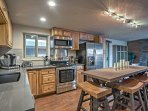 The kitchen is fully equipped with stainless steel appliances and ample counterspace.