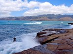 SURFING BY CHINA WALLS AT PORTLOCK POINT