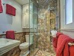 The master bedroom offers an en-suite bathroom with walk-in shower.