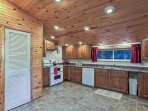 The kitchen features modern appliances, a double sink, and generous counter space.