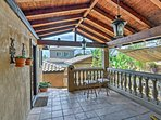 Step out onto the balcony to enjoy a glass of wine, along with tropical views.