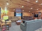 In the living room, you'll find 3 plush sofas, a leather chair, and flat-screen satellite TV with DVD player.