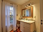 Freshen up throughout the day at the vanity sink with face mirror & comfy stool.