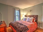 The downstairs bedroom hosts a plush queen bed, cable TV, and en-suite bathroom.