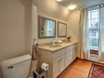 The upstairs bathroom has a double sink, walk-in shower, and large soaking tub.