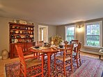 Enjoy meals in the expansive dining room at the 8-person table.