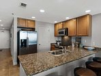 Granite counter tops and stainless steel appliances in this kitchen