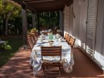 Long table under the veranda for breakfast or lunch and dinner