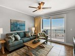 Living room offers a queen sleeper sofa and balcony access!