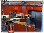 Full kitchen, fridge/freezer, microwave, range, toaster, coffee pot, all utensils, china.