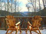 Mountain views from the viewing deck with BBQ, swing and rocking chairs