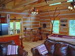 Hand crafted mountain laurel, stair rails, trees reach to the beams to bring nature into the cabin