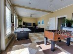 The Beach Club game room with foosball, air hockey, ping pong and a huge TV.