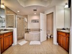 Master bathroom has private lavatory, dbl sink, shower and garden tub.