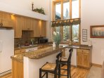 Large windows allow sunshine to light up the fully equipped kitchen
