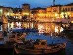 Agios Nikolaos lit by the many tavernas