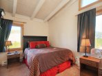 Guest Bedroom - One of the guest bedrooms features a queen-sized bed.