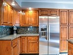 The fully equipped kitchen has stainless steel appliances and sleek granite countertops.