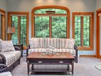 Sip your morning coffee in this warm and welcoming sunroom.