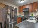 Prepare a home-cooked meal or pack a picnic for the beach with ease in this fully equipped kitchen.