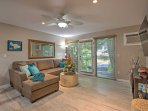 An open floor plan welcomes you to this beautiful end unit with contemporary island decor throughout.