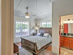 The master bedroom features a queen bed.