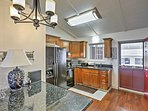 The fully equipped kitchen lies just beyond the living room.