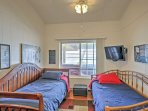 The kids will love cuddling up the 2 twin beds in the other bedroom.