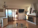 Living Room with log Burner, UHD TV plus Bluetooth soundbar, and views across Costa del Azahar