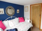 This first floor room has a coastal theme and the daybed is a lovely place to snuggle and relax.