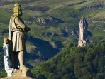 Robert the Bruce statue with Wallace Monument in background take from Castle esplanade