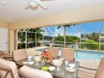 Lanai with outside dining and seating