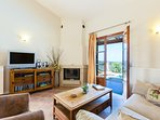 """Living room with : 32"""" TV,  DVD , book library , fireplace & exit to outdoors"""