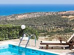 Sun beds by the pool , enjoy the sea, mountain and gorge views