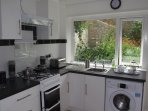 Looking out onto the beautiful garden from the kitchen with very efficient washing machine.