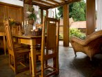 Elegant Oak table and 4 dining chairs. Almost alfresco. Intimately  cave like when privacy required.