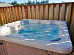 A high fence insures privacy in the luxurious hot tub.