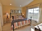 Master suite with a king bed on the upper level.