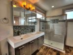 Sunlight, and clean impeccable design hallmark this fabulous bath.