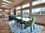 Hardwood flooring gleams in the light from skylights and a wall of windows.