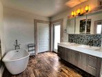 The modern design continues in an amazing bath with soaking tub and double vanity sink.