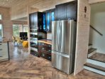 The centerpiece of the main level is a large, well stocked kitchen, with gleaming stainless steel.