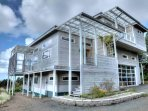 Contemporary multi-level masterpiece in Seal Rock, on a quiet drive.