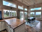 The amazing  kitchen flows into the dining area and living room.