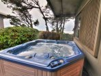 Hot tub with ocean view.