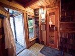 Spa bath - entrances to glass brick shower and sauna.