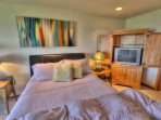 Another colorful comfortable bedroom.