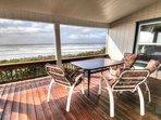 Enjoy the sunset, waves, or whale watch from the covered back porch.